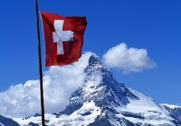Swiss flag in front of the Matterhorn, Zermatt, Valais, Switzerland, Europe